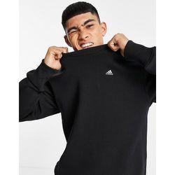 Adidas Training - Sweat-shirt confort à petit logo - adidas performance - Modalova