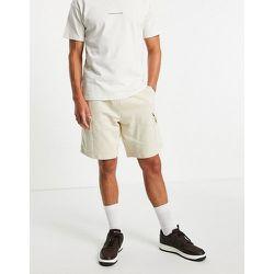Short oversize en jersey avec poches cargo - ASOS DESIGN - Modalova