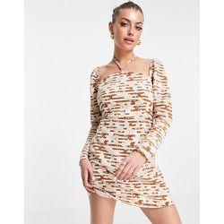 Robe courte coupe droite avec lien à nouer derrière la nuque et imprimé fleuri rétro - Fashion Union - Modalova